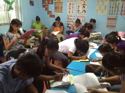 Doing review papers---the two in the bottom left-corner are a husband and wife who will be sitting for the elementary level exam.