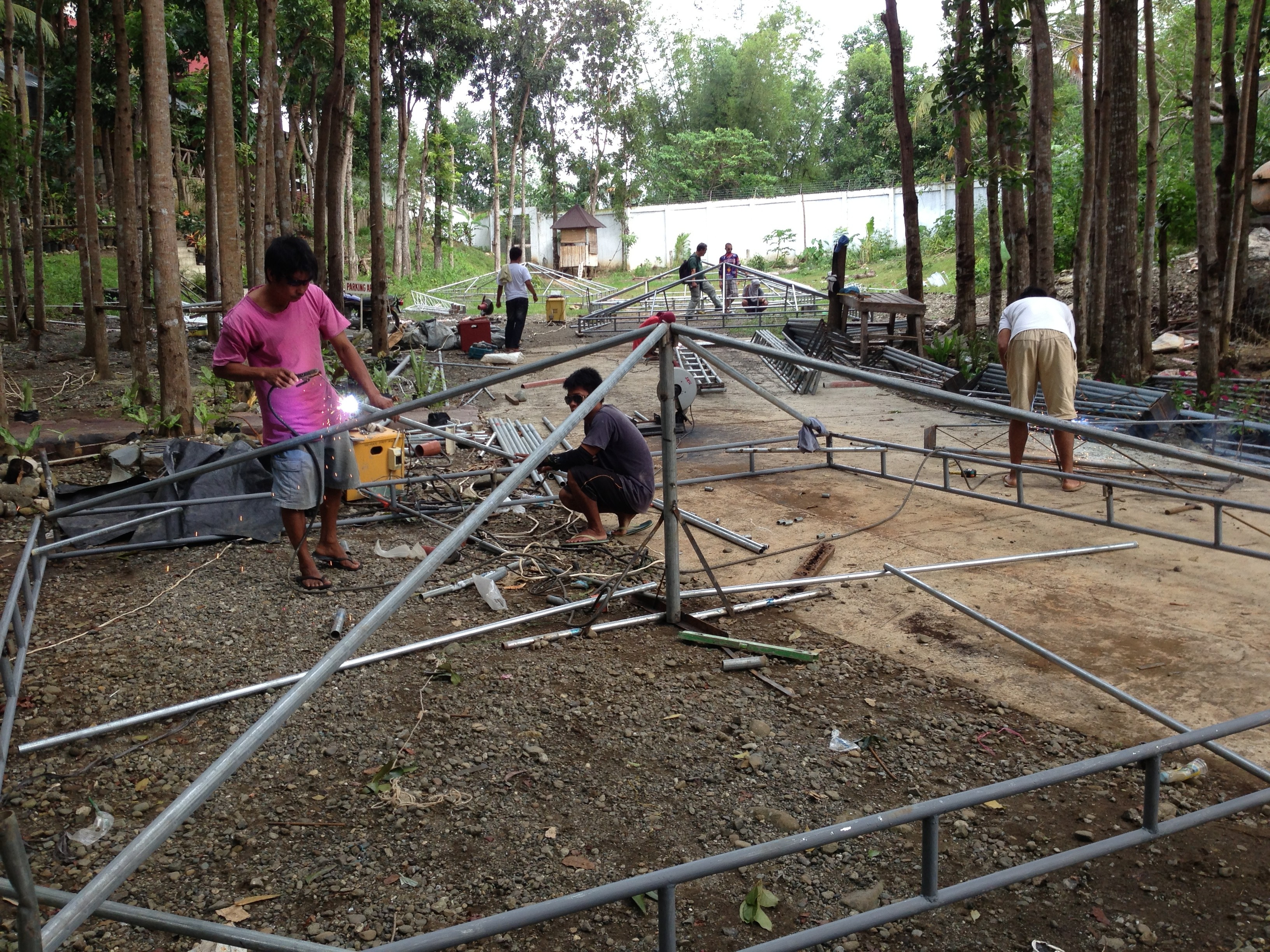 Making tent frames & Goducate makes tents for schools damaged by Typhoon Haiyan ...