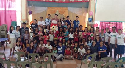 Musicians with Jollibee mascot, AIESEC members, and Goducate staff