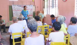 A potential trainer conducting a health information session for adults