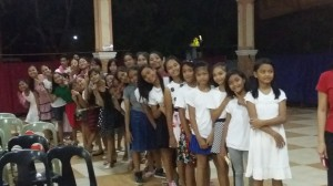 Children queueing up for gift of school supplies