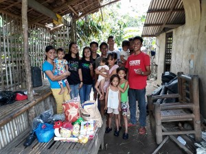 Junnel in Red Shirt, together with basketball players, community youth and Nanay Cheryll's Family